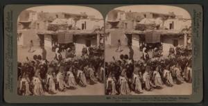 The_Kachina_dance_to_the_rain-god,_Hopi_Indian_village,_Shonghopavi,_Arizona,_by_Underwood_&_Underwood